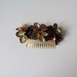 Gold flower comb and brown and copper brooches
