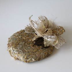 Gold lace and flowers cap.